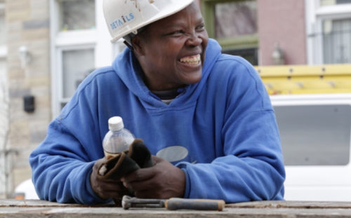 Bernadette Buckson is rebuilding her life by helping to tear down her old neighborhood, by hand.