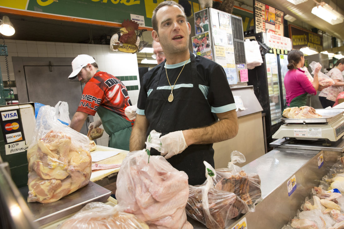 Ben David, packs up chicken wings for a customer. Working behind him are Timothy Dudley left, Chuck Chaplan, center, and Jaira Boone, David's girlfriend.