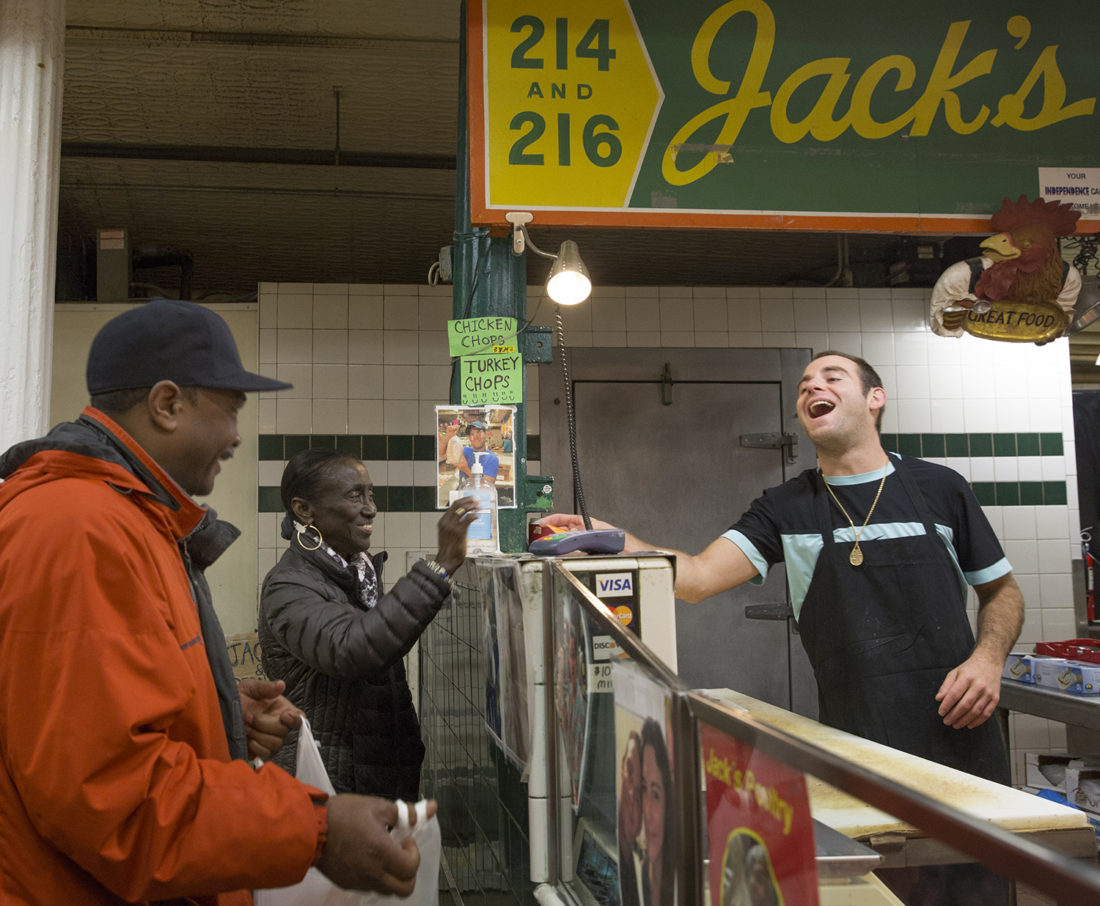Philip Lowery and Ben David enjoy some friendly banter on a Saturday morning at Hollins Market. / Photo by Yukai Peng