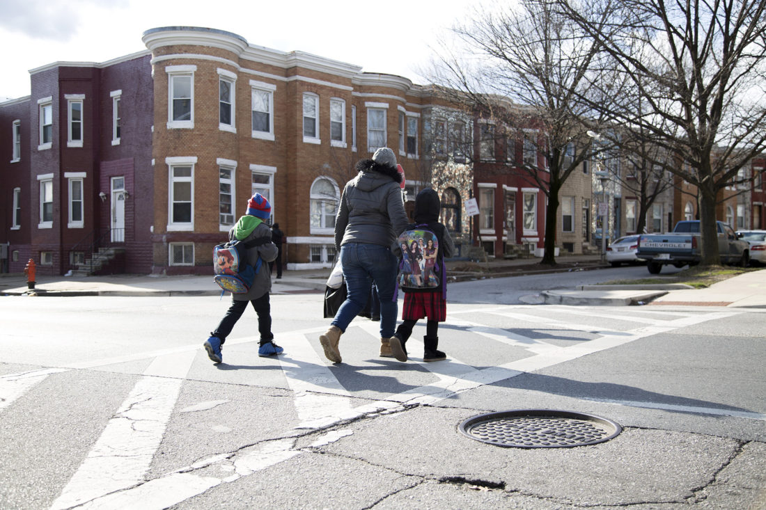 Pedestrians cross North Fulton Avenue at the end of the school day at the combined John Eager Howard and Westside elementary schools in the Penn-North neighborhood of Baltimore on Friday, March 10, 2017. Students from the former John Eager Howard Elementary in Reservoir Hill travel each day to the combined campuses while John Eager Howard is being refurbished. The new school will be renamed Dorothy I. Height Elementary School.