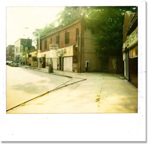 The Whitelock Street business district in Reservoir Hill is shown in a 1980s Polaroid photo. / Image courtesy of the Reservoir Hill Improvement District