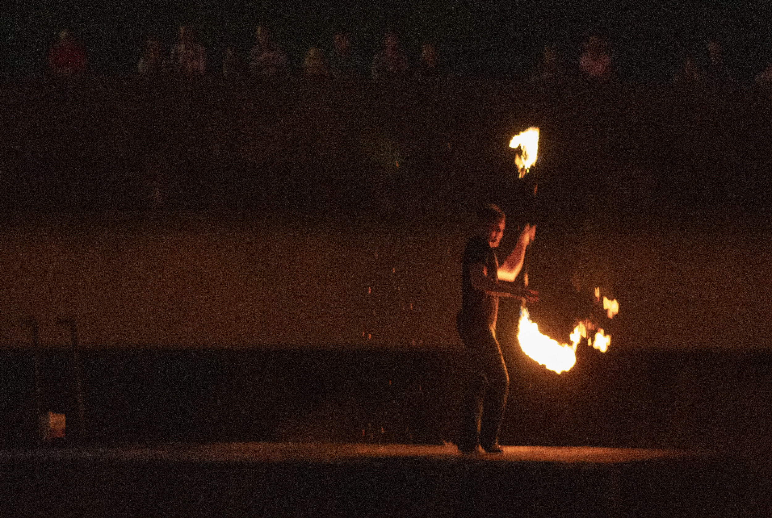 After the waterfires were lit, all attention was drawn to a performer and his flaming batons. Photo by Teagan Staudenmeier