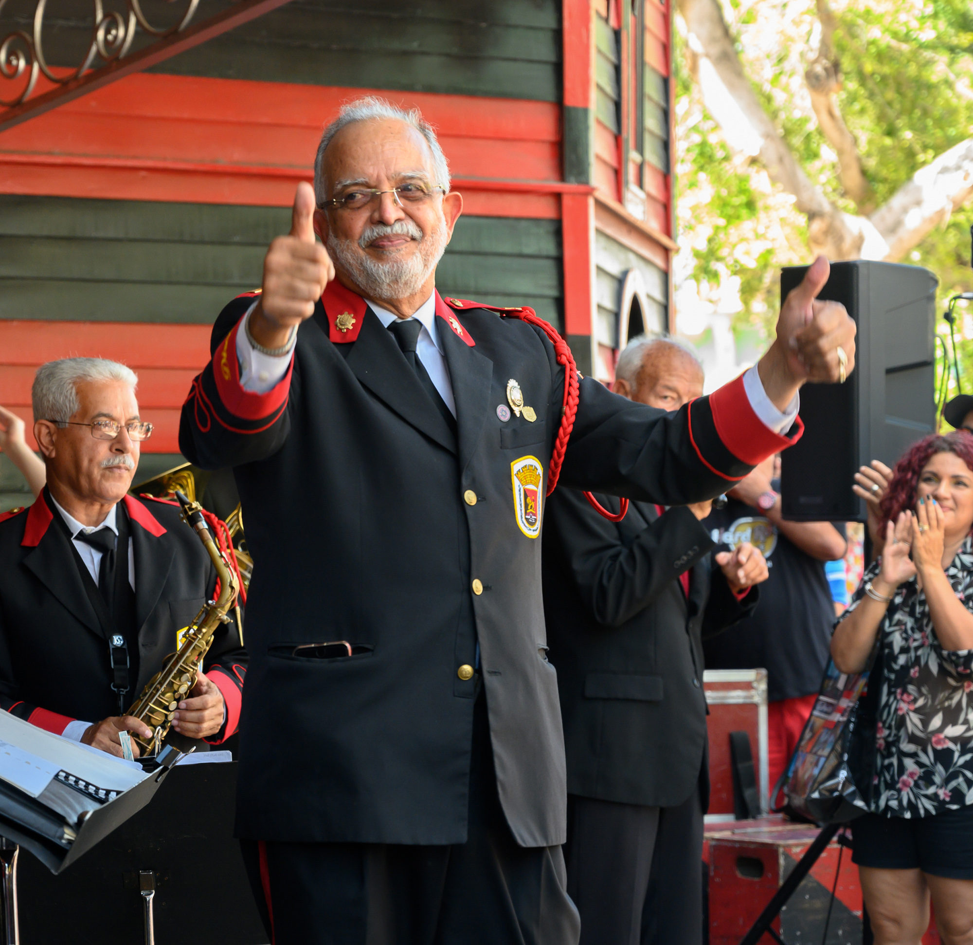 Juan García Germaín, the director of the Ponce Municipal Band, gives a thumbs-up to the audience following their performance at Parque de Bombas during Carnaval Ponceño in Ponce, Puerto Rico on Sunday, March 3, 2019. Photo by Sydney Herdle.