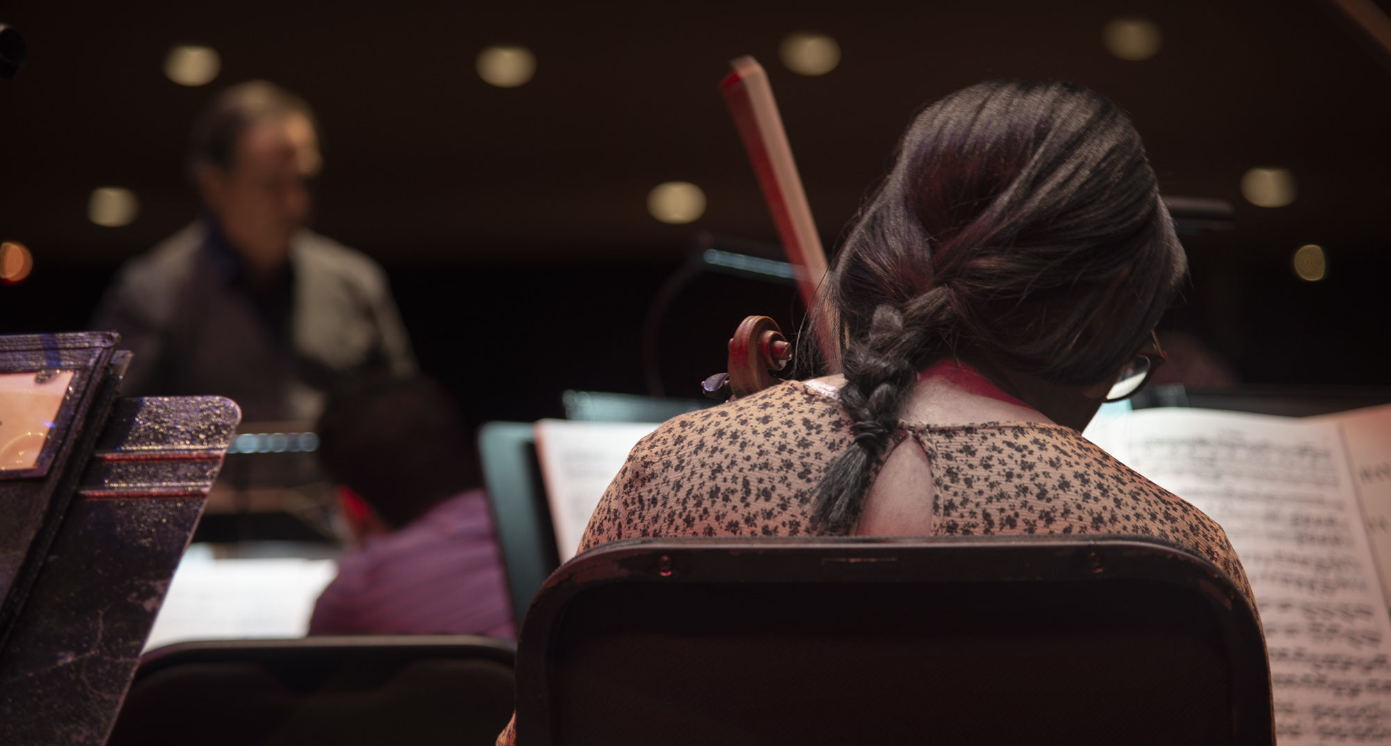 A violin player prepares for the long practice ahead. At the time, the orchestra was practicing for the Casals Festival, a classical music festival held every year in Puerto Rico. Photo by Erin McLoughlin