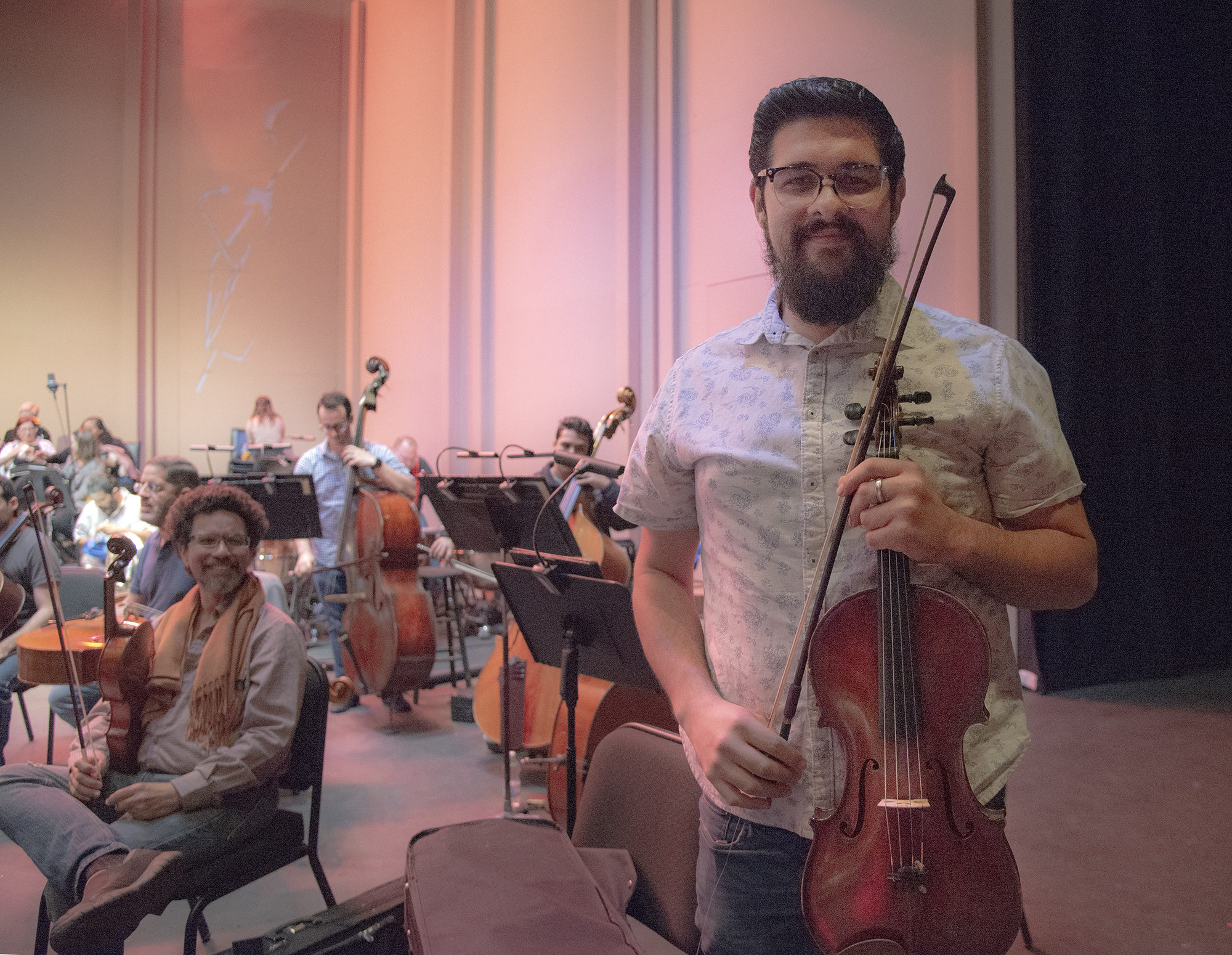 Violist Edgardo Rosaly Sampoll said musicians still managed to meet up for informal practices despite the chaos after the hurricane. He says he is glad the orchestra has. found a way to give back to the community through relief concerts. Photo by Erin McLoughlin
