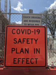 A warning sign in front of an idled construction site on College Ave in Downtown State College. Photo by Lesley Cosme